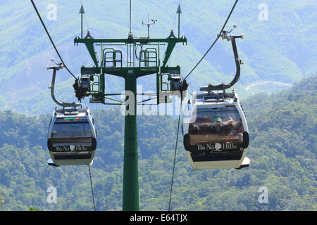 DANANG,VIETNAM – JULY 15: Tourists passenger cable car up the beautiful views on the mountain on July 15,2014 in - Stock Photo