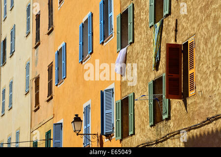 Row of houses with colourful shutters, L'Île Rousse, Balagne, Corsica, France - Stock Photo