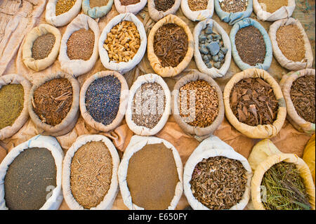 Spices in bags, on sale at a souk, Southern Morocco - Stock Photo