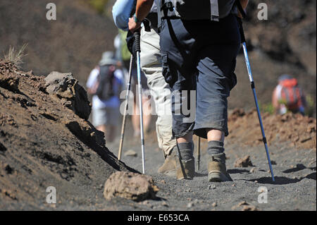 People walking and hiking on volcano trail in the Haleakala crater, Maui Island, Hawaii Islands, USA - Stock Photo