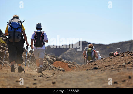 Hikers walking in the Haleakala crater, Haleakala National Park, Maui Island, Hawaii Islands, USA - Stock Photo