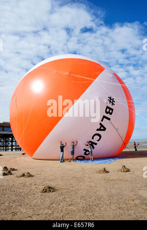 Blackpool now holds the Guiness World Record for the biggest beach ball in history. The seaside resort had it's - Stock Photo