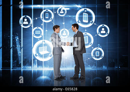 Composite image of businessmen shaking hands - Stock Photo