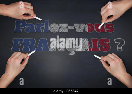 Composite image of multiple hands writing with chalk - Stock Photo