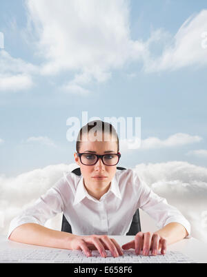Composite image of businesswoman typing on a keyboard - Stock Photo