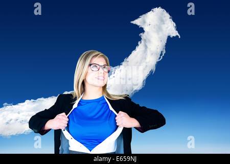 Composite image of businesswoman opening her shirt superhero style - Stock Photo