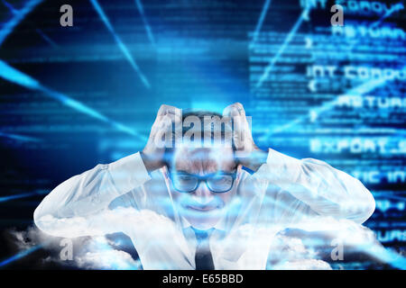Composite image of stressed businessman touching his head - Stock Photo