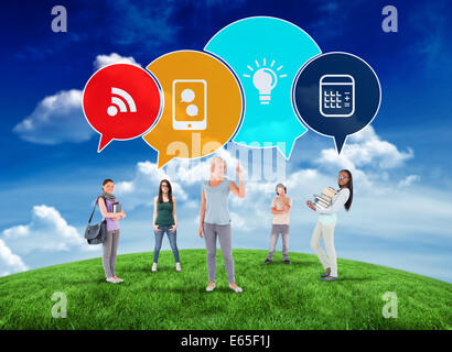 Composite image of happy students with speech bubbles - Stock Photo