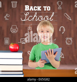 Composite image of cute boy using tablet - Stock Photo