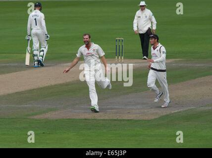 Emirates Old Trafford, Manchester, UK. 15th Aug, 2014. Tom Smith (Lancashire) celebrates taking the first wicket - Stock Photo