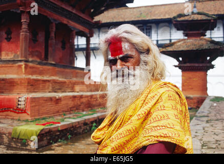 Hindu ascetic ('sadhu') in a temple with typical Newari design ( Nepal) - Stock Photo