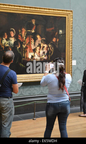 National Gallery, London, UK. 15th August 2014. National Gallery now allows visitors to take photographs, realising - Stock Photo