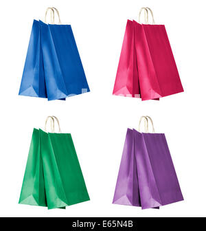 Four color shopping bags isolated on white background. - Stock Photo