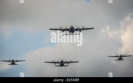 Warsaw, Poland. 15th August, 2014.  Polish Air Force C-130 Hercules and EADS CASA C-295 aircrafts fly over city - Stock Photo