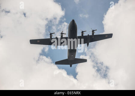 Warsaw, Poland. 15th August, 2014.  Polish Air Force C-130 Hercules aircraft fly over city during the biggest military - Stock Photo