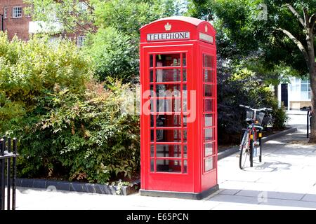 Traditional English red phone box. - Stock Photo