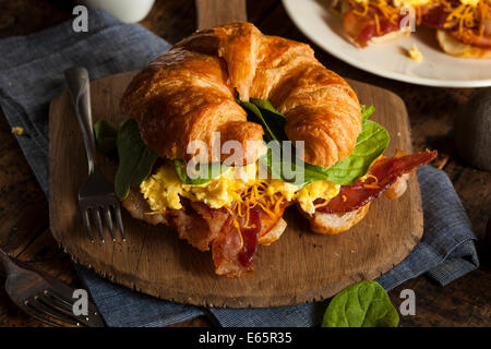 Ham and Cheese Egg Breakfast Sandwich on a Croissant - Stock Photo