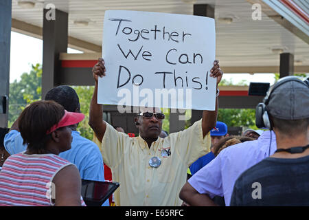 Ferguson, Mo., US. 15th Aug, 2014. Man at the Site of destroyed Quick Trip Holds sign after Police Chief Thomas Jackson release of the name of the officer that shot Michael Brown. Credit:  Gino's Premium Images/Alamy Live News