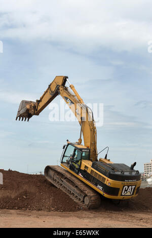 Excavator  working  on I-95 New Haven Harbor Crossing Project re-use pile. - Stock Photo