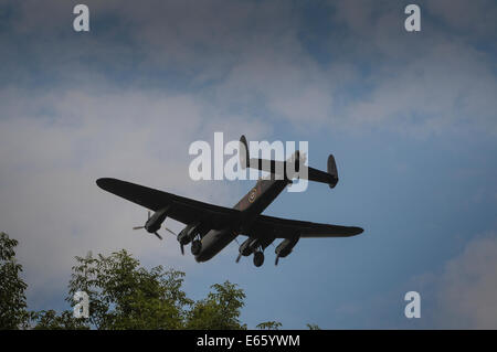 Biggin Hill, Kent, UK..15 August 2014..Lancaster Bomber KCA on final approach to Biggin Hill airfield over the Kent - Stock Photo