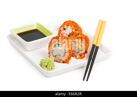 Maki sushi rolls on the plate with chopsticks - Stock Photo