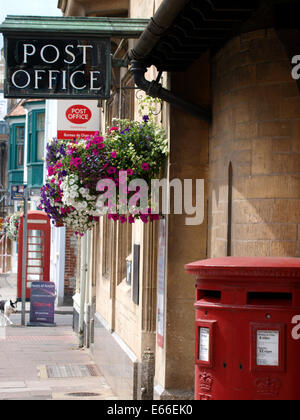 Post Office postbox and signs, Glastonbury, Somerset, UK - Stock Photo