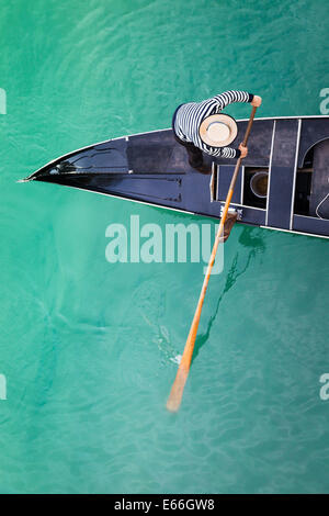 View of gondola and gondolier from above with a bridge across the Grand canal - Stock Photo