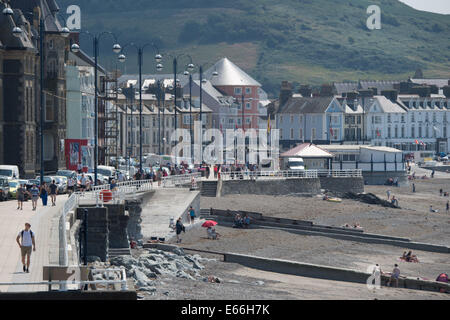 Aberystwyth, Wales, UK. 24th July, 2014. 11-AFTER: BUSY PROMENADE 6 MONTHS AFTER THE STORM. Six months after devastating - Stock Photo
