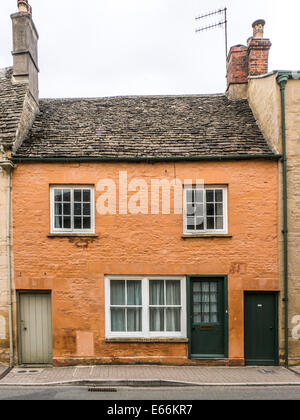 Attractive, painted, period house, with three front doors, built in local cotswold stone, Cirencester town, Cotswolds, - Stock Photo