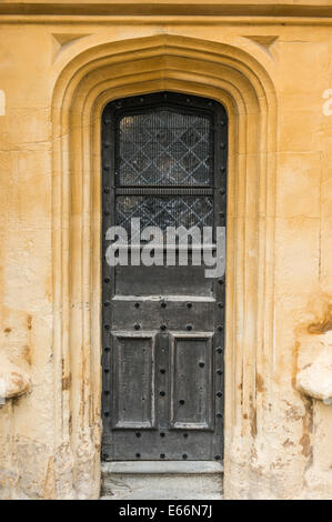Ornate wooden door from a section of the south porch of the Church of St John Baptist, Cirencester, Cotswolds, Gloucestershire, - Stock Photo