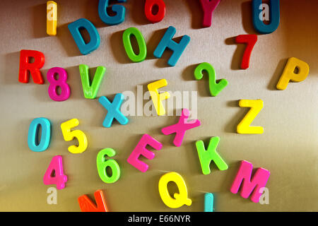 Colorful magnetic letters on refrigerator - Stock Photo