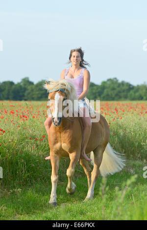 Woman Riding Bareback On Horse Stock Photos & Woman Riding