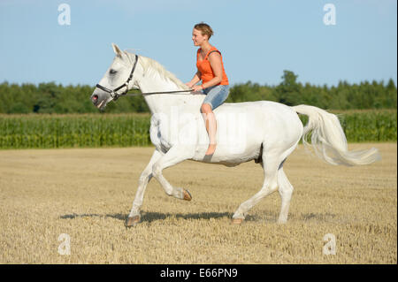 Woman riding bareback on a 23-year-old Bavarian horse