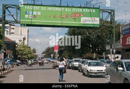 People and traffic on Kenyatta Avenue Nakuru Kenya East Africa with advertising hoarding for 3g Network   KENYATTA - Stock Photo
