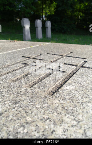 engraved crosses in a marble plate on graveyard - Stock Photo