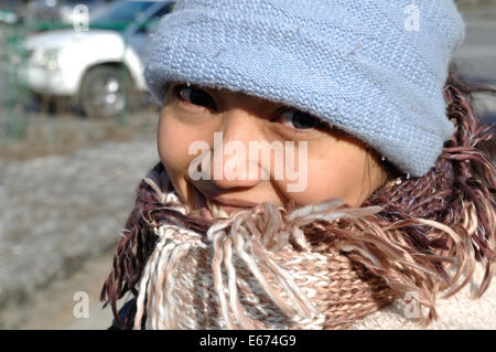 Asian Woman dressed for cold winter in Mongolia - Stock Photo