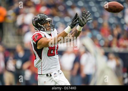 Houston, Texas, USA. 16th Aug, 2014. Atlanta Falcons tight end Levine Toilolo (80) warms up prior to an NFL preseason - Stock Photo