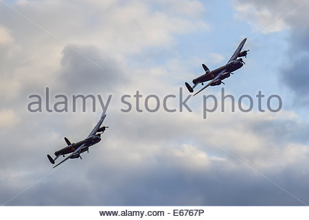 Old Warden, Bedfordshire. 16 Aug 2014. The last two flying Avro Lancaster Bombers take part in an Air Display at - Stock Photo