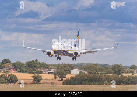 A Ryanair Boeing 737 coming in to land at Luton Airport in England , Britain , Uk - Stock Photo