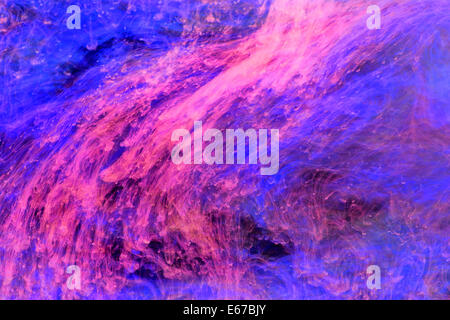 abstract background with vibrant floating color strings in underwater ambiance - Stock Photo