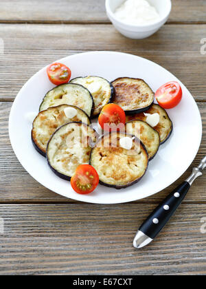 roasted eggplant  with garlic pieces, food - Stock Photo