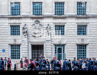 London, UK - 17 August 2014: a group of men in traditional dress in London during the parade for the Grand Opening - Stock Photo