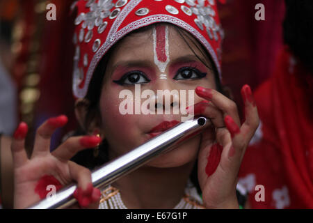 Dhaka, Bangladesh. 17th Aug, 2014. Bangladeshi Hindu children dressed like Lord Sri Krishna take part in the celebration - Stock Photo