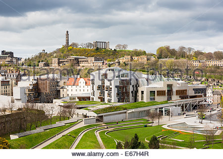 View of the Scottish Parliament and the Calton Hill from the Arthur's Seat, Edinburgh, UK - Stock Photo