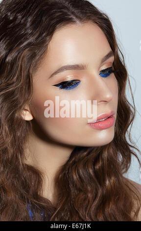 Visage. Pensive Woman with Blue Mascara and Holiday Makeup - Stock Photo