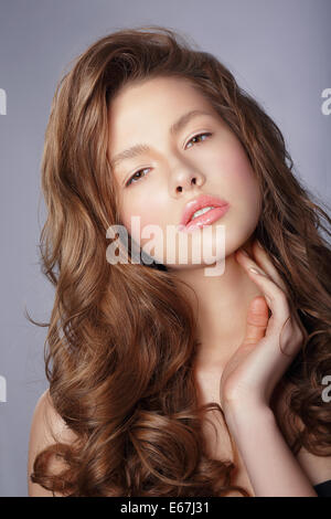 Tenderness. Young Woman with Long Healthy Loosing Hair - Stock Photo
