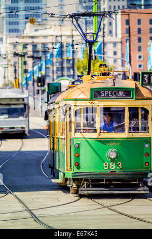 Yellow and green traditional iconic Melbourne tram, Australia - Stock Photo