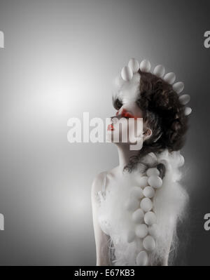 Creative Concept. Styled Futuristic Woman with Fantastic Headwear - Stock Photo