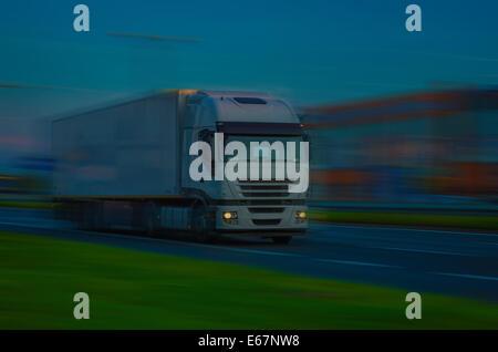 White Truck - Speeding on HIGHWAY - Stock Photo
