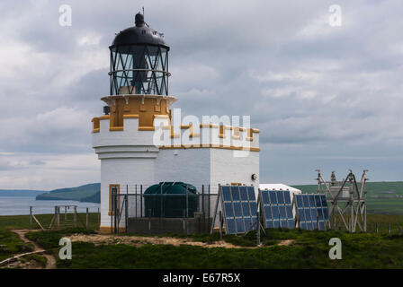 The unmanned Brough of Birsay Lighthouse built by David A Stevenson on the Orkney Islands, Scotland - Stock Photo